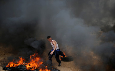 Demonstrator reacts during a protest where Palestinians demand the right to return to their homeland, at the Israel-Gaza border, east of Gaza City
