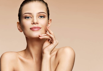 Young girl with fresh daily make-up. Photo of attractive girl with perfect skin on beige background. Youth and skin care concept