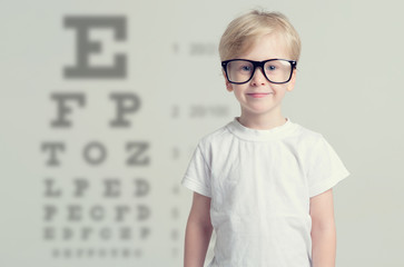 Little boy having eye test. Tables vision testing. Visiting a doctor pediatric ophthalmologist.