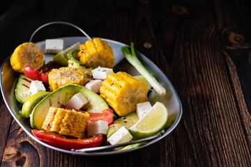 Grilled vegetables, corn cobs, zucchini, red pepper.