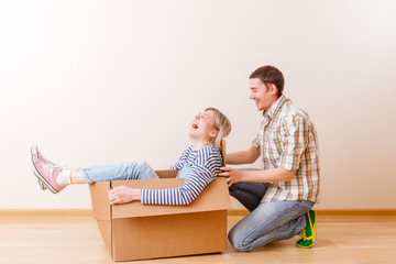 Photo of blonde in cardboard box and man