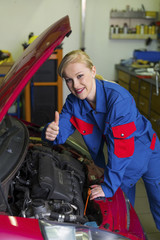 woman as a mechanic in auto repair shop