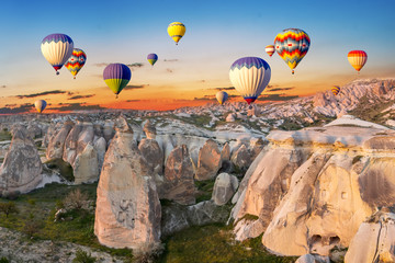 Hot air balloons at sunset over the cave town, Cappadocia, Turkey