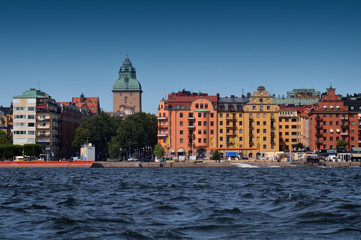 Waterside settlement full of iconic buildings at port of Kungsholmstorg brygga in Stockholm, Sweden
