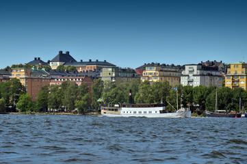 Waterside settlement full of iconic buildings at port of Kungsholmstorg brygga in Stockholm, Sweden