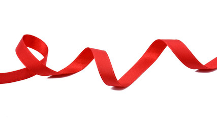 spiral of red fabric ribbon isolated on white background