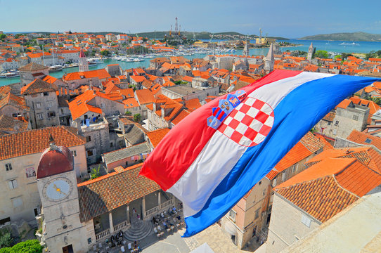 Flag and view on Trogir from Cathedral of Saint Lawrence, Croatia.