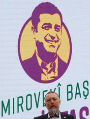 Sezai Temelli, co-leader of the pro-Kurdish HDP, with an image of Demirtas, the party's jailed former co-leader and the candidate for the upcoming presidential election in the background, speaks during a gathering in