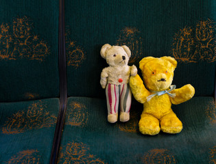 Teddy bears from the 1940s and 50s on a train ride
