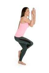 Woman doing yoga asan Garudasana (Eagle Pose)
