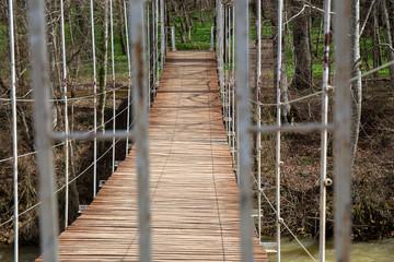 Suspended wooden bridge. the passage is closed on the bridge.