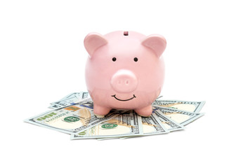 Piggy bank with money on white background.