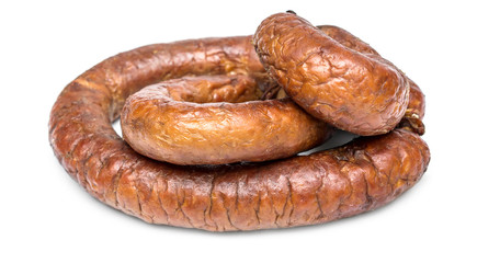 Heap of smoked sausage on white background.
