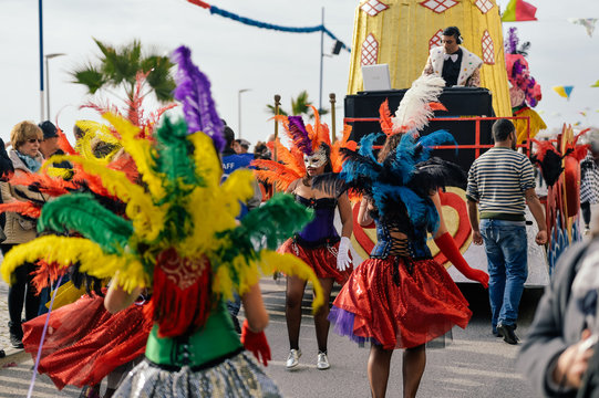 Dancers in costumes performing at the Carnival Parade on outdoors background