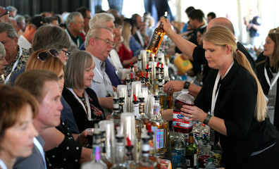 Shareholders line up at a massive bar at the opening cocktail party for the Berkshire Hathaway Inc annual meeting, the largest in corporate America, in its hometown of Omaha