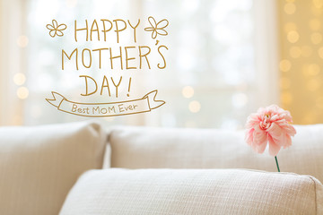 Mother's Day message with a flower in a bright interior room sofa