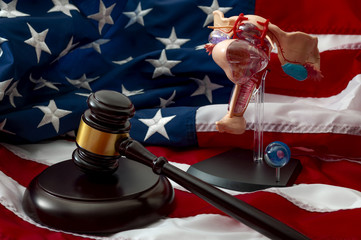 Law regarding aborting a pregnancy, reproductive rights and abortion legislation concept with a medical model of the female reproductive system, a judge gavel and the american flag in the background