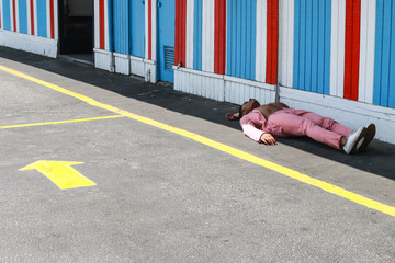 Man lying on the side of road