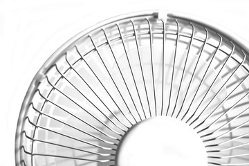 Part white desktop office fan with propeller blades of transparent plastic. Isolated