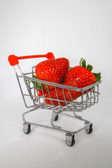 Strawberries in a Miniature Shopping Cart.