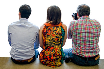 Three spectators people sitted and taking photos isolated over white