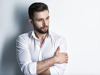 Handsome man in white shirt. Closeup portrait.