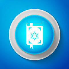 White Jewish torah book icon isolated on blue background. The Book of the Pentateuch of Moses. On the cover of the Bible is the image of the Star of David. Circle blue button. Vector Illustration