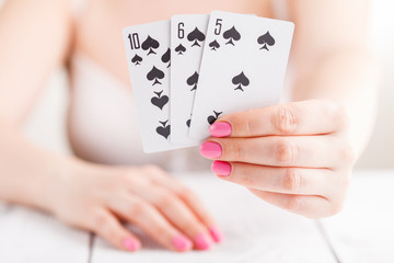 Black Jack card in playing cards game in the female hand