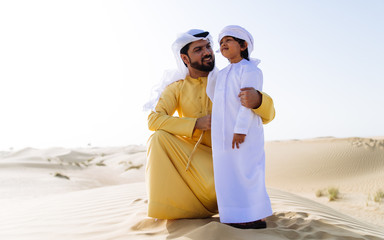 Father and son spending time in the desert