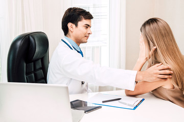 Doctor consulting and holding hand female patient reassuring with care on doctors table in hospital.healthcare and medicine