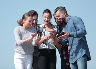 closeup. the group of students using smartphones.