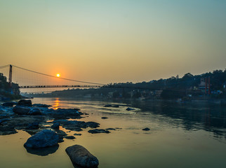 View of River Ganga and Ram Jhula bridge silhouette  Rishikesh. India.