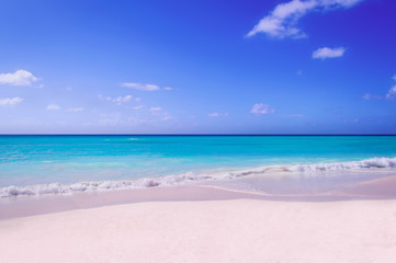 A deserted beach with white sand of the island of Saone. A view of the horizon of the Caribbean Sea.