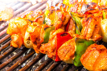 Grilled skewers of vegetables and meat on the grill.