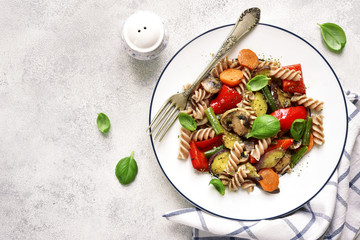 Whole grain pasta with mushrooms and vegetables.Top view.
