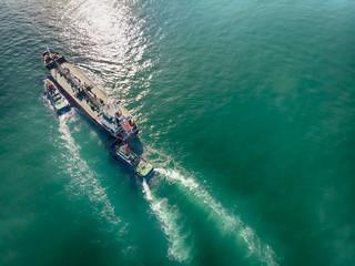 Gas ship and pilot ship navigate to dock yard port.