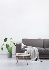 4359152 Modern vintage living room. Brown leather sofa on a grey wooden floor and light wall. 3D render.
