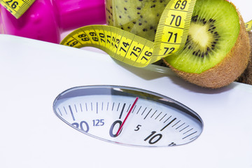 scale, green smoothie and dumbbells. diet and slimming concept