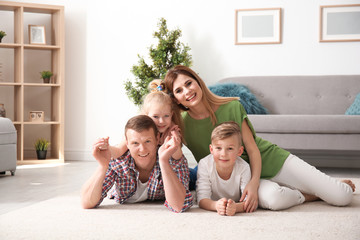Happy family on cozy carpet at home