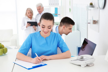 Young female receptionist working in hospital