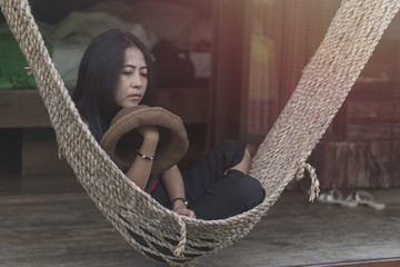 Asian woman is sitting on cradle., relaxing concept. image vintage style.