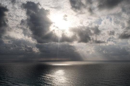 Light burst through storm clouds - Cancun Mexico