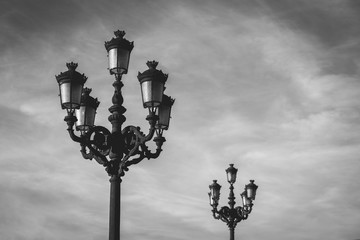 Popular ornate lamp posts over cloudy sky background in Bilbao city, north Spain