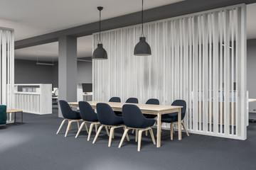 Wooden meeting room corner, black chairs
