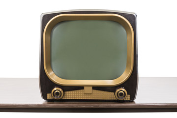 Vintage 1950s television on table isolated on white with clipping path.