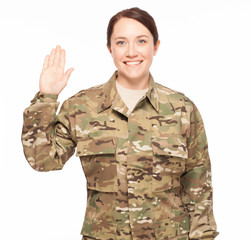 Oath of enlistment for female soldier smiling.