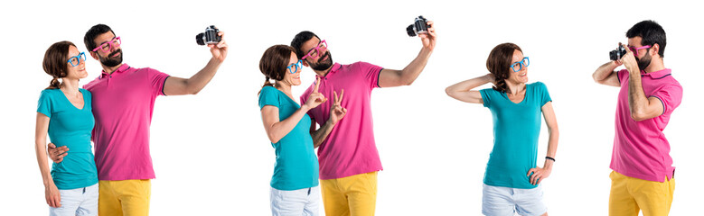 Couple in colorful clothes making a selfie