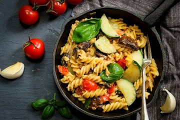 Homemade Pasta Primavera with vegetables on Iron Skillet, overhead view