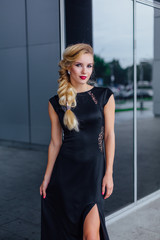 Attractive lady in long evening dress on the street