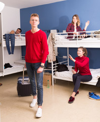 Man traveler leaving hostel room